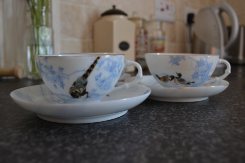 Hand painted cups ans saucers x3