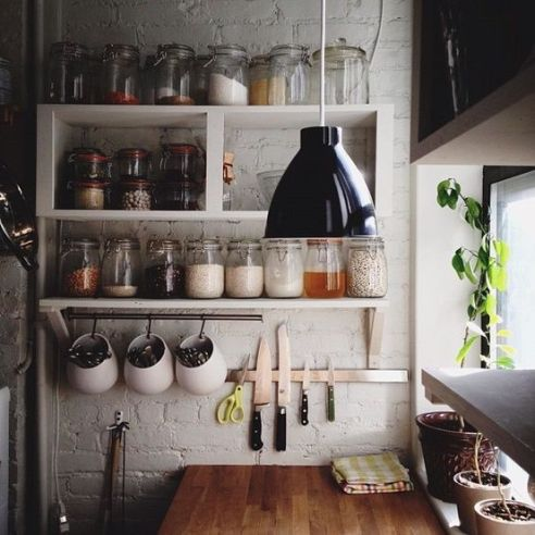 Love white brick walls and storage jars...